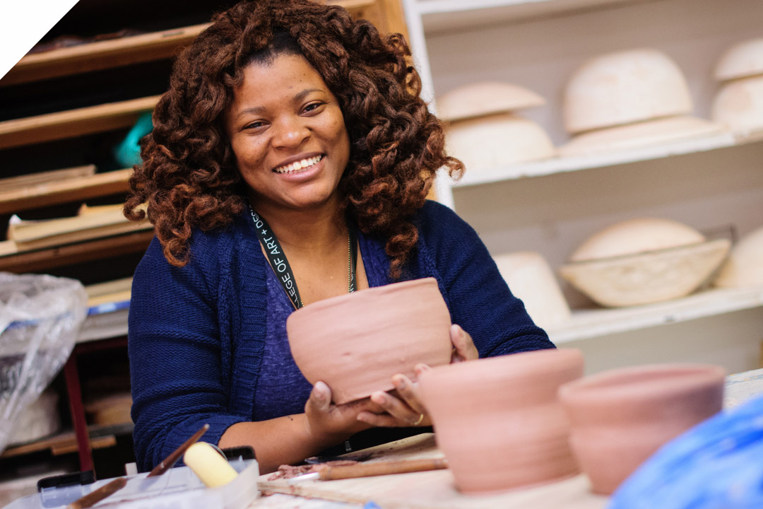 Corcoran Continuing Education student working on pottery