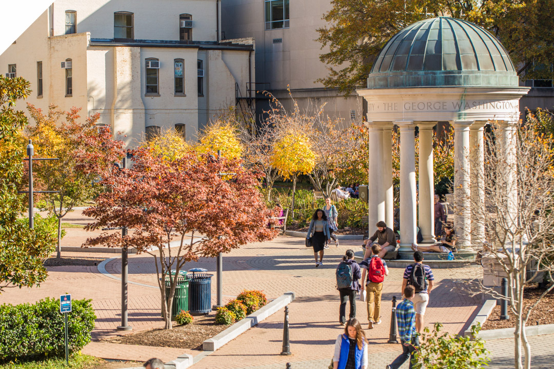 students walking through Kogan Plaza on Foggy Bottom Campus on fall day