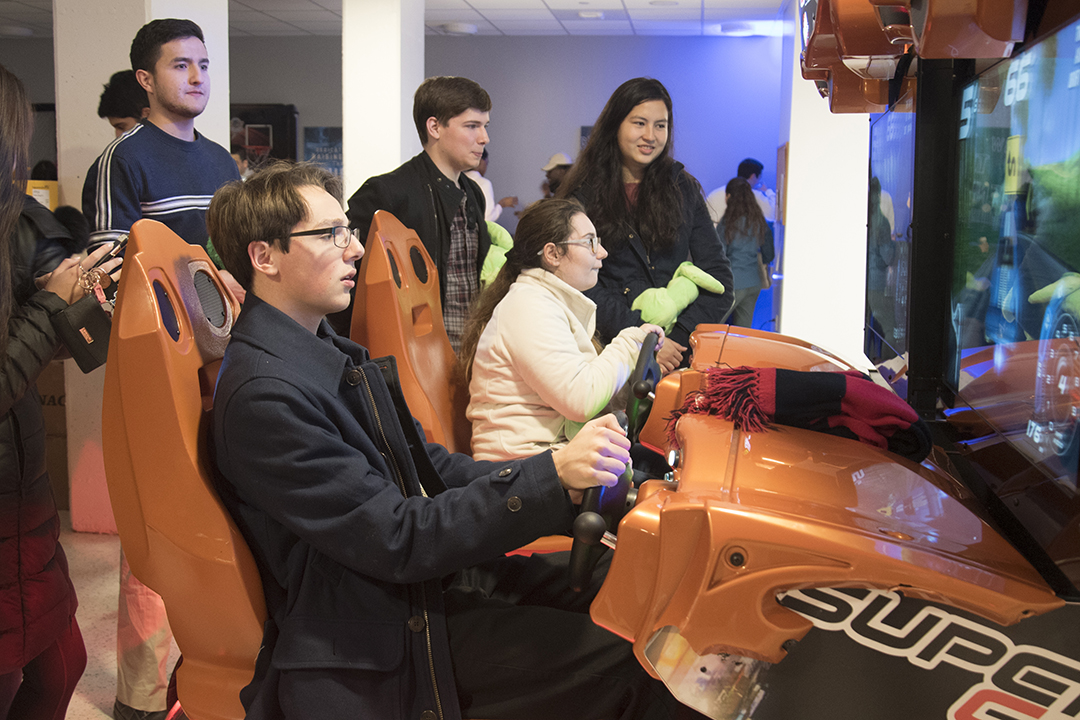 student playing an driving arcade game