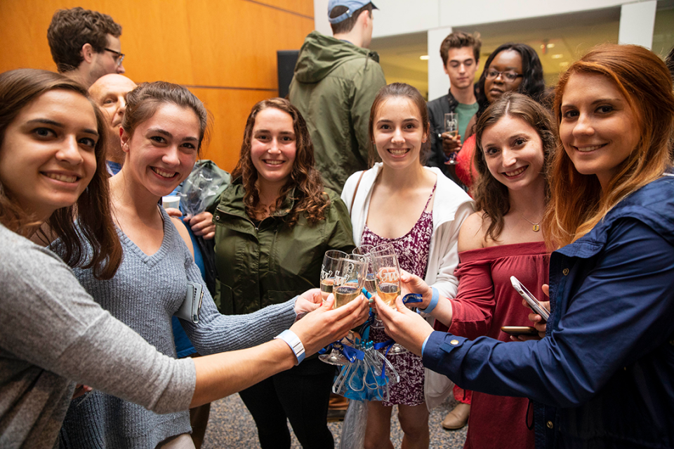 Group of students with champagne toasts