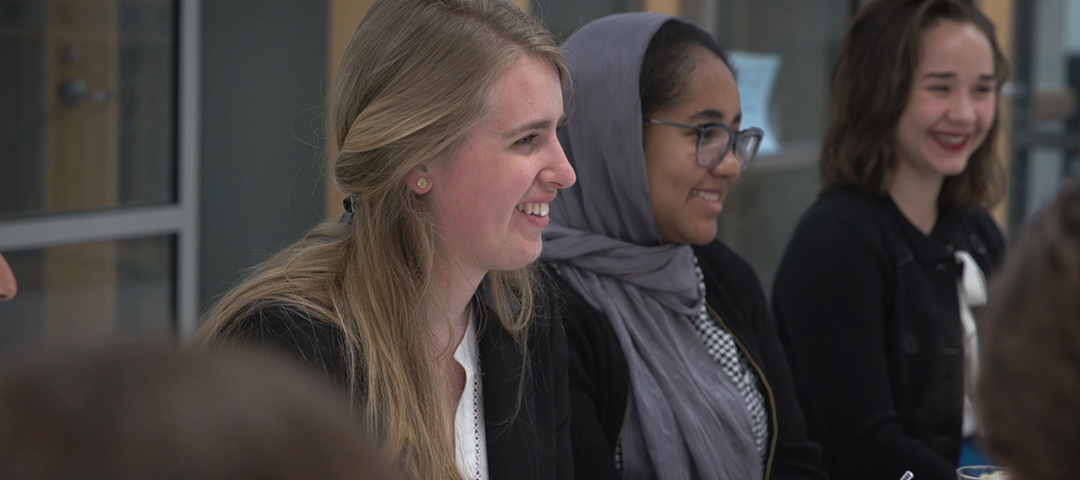 Three smiling female students