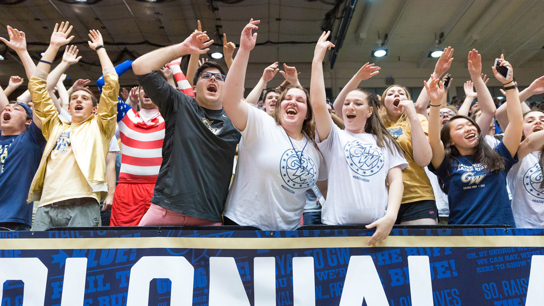 Student fans cheering for GW