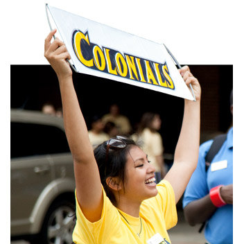student holding colonials sign