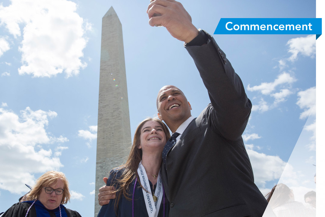 Students taking selfie with Senator Cory Booker during Commencement