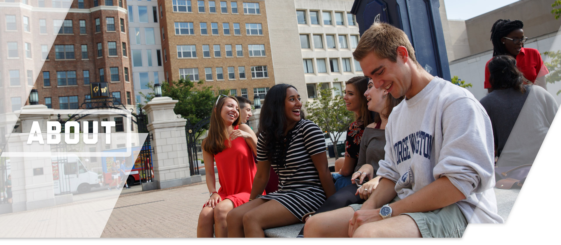 About; Students in front of the clock tower in Kogan Plaza on Foggy Bottom Campus