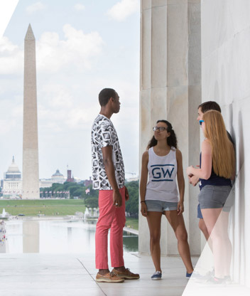 Four students talking at the Lincoln Memorial with the Washington Monument in the background