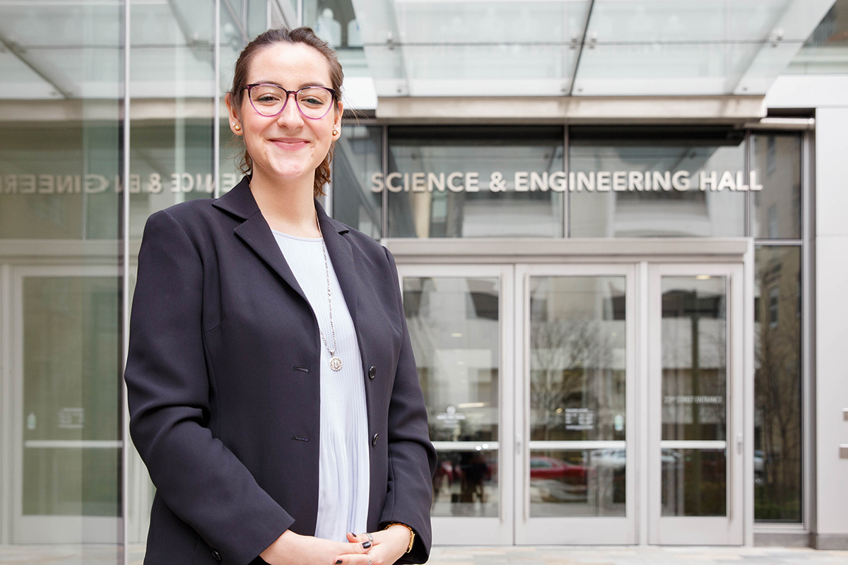 a photo of jessica thompson standing in front of the science and engineering hall