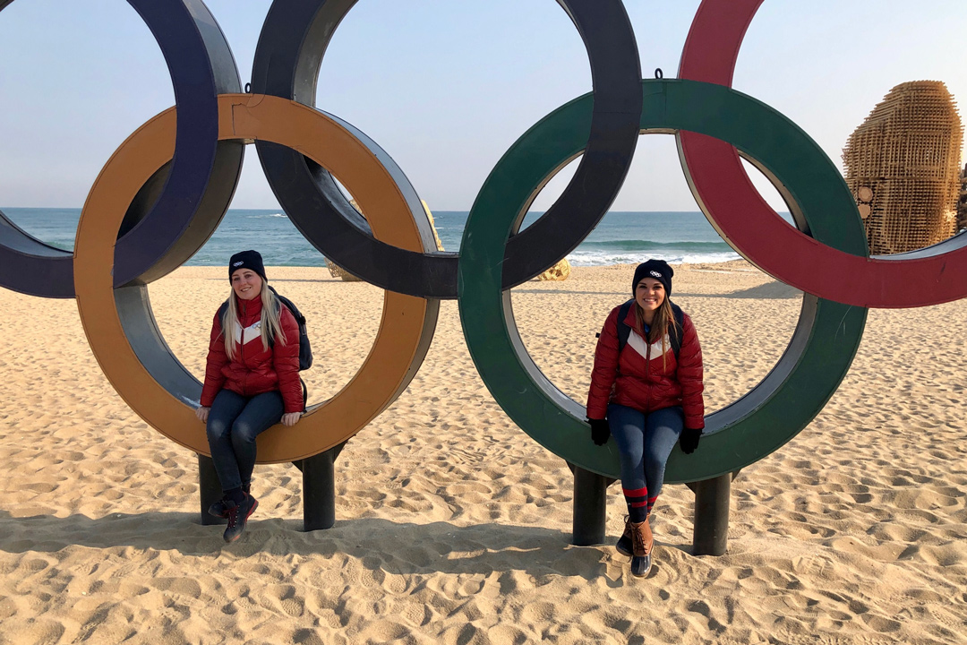 GW students sitting in Olympic Rings in South Korea beach